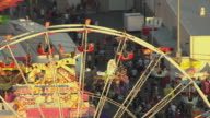 MS AERIAL Riders sitting in ferris wheel seats above Arizona State Fair / Phoenix, Arizona, United States