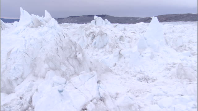 Ridges cover a glacier in Greenland. Available in HD.