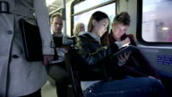 riding a bus and using digital tablet for internet