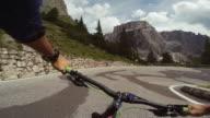 POV riding a mountain bike on a mountain pass