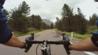 POV riding a road racing bicycle on a mountain pass