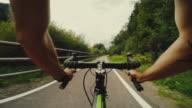 POV riding a road racing bicycle