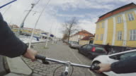 POV riding a urban road city bicycle
