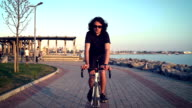 HD: Riding Bicycle at Sunset