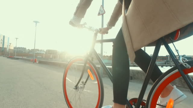 Riding bicycle into the sunset