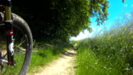 POV Riding Electric Mountain Bike In Spring Close-up