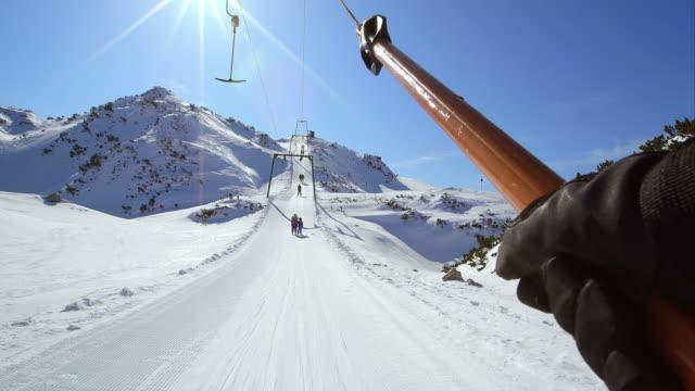 POV Riding the double hanger surface ski lift up slope