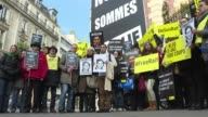 Rights group Amnesty International leads a protest in Paris against the sentencing of blogger Raef Badawi to flogging a case that has sparked...