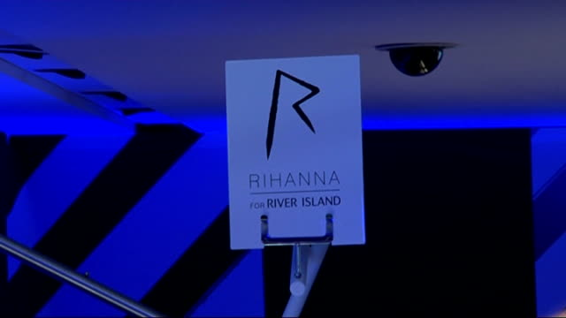 Rihanna launches fashion range for River Island Rihanna photocall and fashion show ENGLAND London River Island EXT GVs Clothes on display and signs...