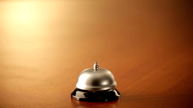 ringing a service bell with fist