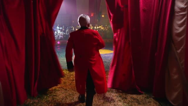 MS POV Ringleader entering circus ring / California, USA