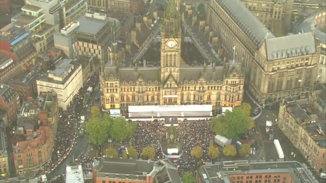 Air views of Manchester victory parade for Team GB AIR VIEWS / AERIALS Crowd gathered in square in front of Manchester Town Hall watching the band...
