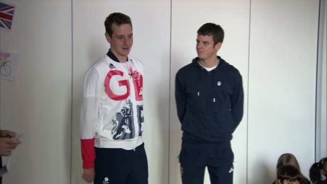 Team GB interviews ENGLAND Manchester INT Alistair Brownlee and Jonny Brownlee along into school assembly and answer questions SOT Alistair Brownlee...