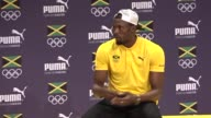 Usain Bolt press conference BRAZIL Rio de Janeiro INT Jonathan Edwards introducing Usain Bolt SOT / Usain Bolt arriving at press conference SOT