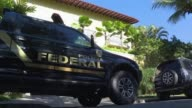Rio de Janeiro police launched raids Tuesday against an international corruption scheme accused of bribing the IOC to vote for the city's bid to host...