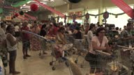 Rio de Janeiro residents look for cheap deals in supermarkets to be able to celebrate Christmas in style despite their ongoing economic woes as the...