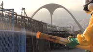 Rio de Janeiro sent fumigators Tuesday into the citys carnival stadium which will also be used for Olympic archery in August to combat an outbreak of...