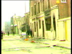 Riot aftermath burnt out cars and buildings still smoking piles of rubble Brixton Riots Apr 81