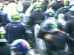 Riot police charge anticapitalist protestors during the May Day demonstrations in central London