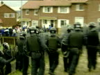 Riot police charge at loyalist rioters throwing stones as Catholic families walk children to Holy Cross Primary School Belfast 5 Sep 01
