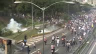 Riot police fired rubber bullets and tear gas to break up an opposition protest on one of Caracas highway as thousands rallied Monday vowing to block...