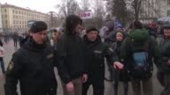 Riot police in Minsk detain protesters during a rally against President Alexander Lukashenko's rule and a controversial new tax on spongers