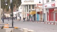 Riot police intervene to the protesters during a protest staged by unemployed young citizens against unemployment and poverty in Kassarine Tunisia on...