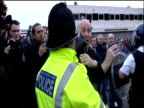 Riot police struggle to control football fans during violent disturbances at Old Trafford football ground prior to Manchester United vs Roma...