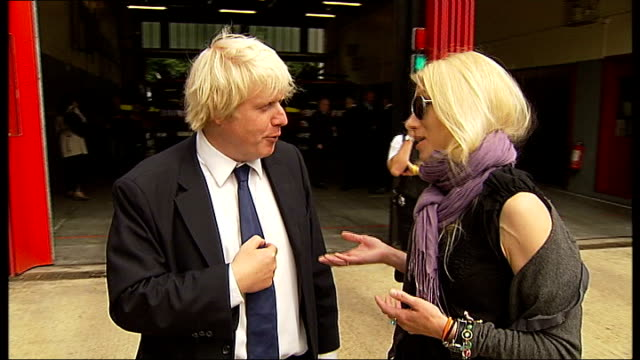 Riots Boris Johnson visits fire station in Stoke Newington Johnson chatting to woman SOT On whether people will be made to do community service /...