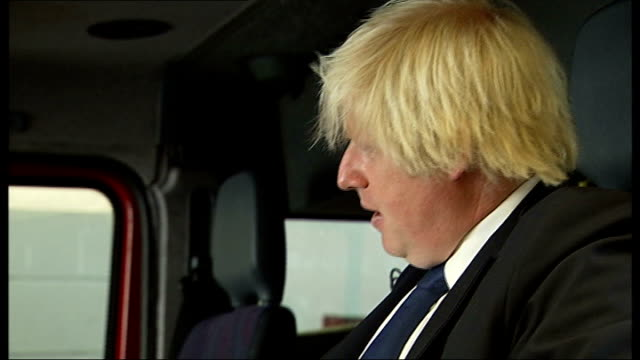 Riots Boris Johnson visits fire station in Stoke Newington Johnson chatting to firefighters SOT / Johnson being shown fire engine / Johnson climbing...