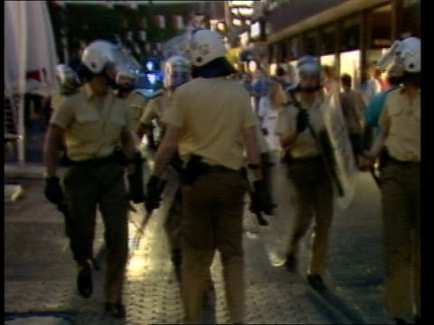 Riots follow England defeat ITN W GERMANY Dusseldorf EXT MS Crowd of fans roaming streets PULL OUT riot police along in f/g PAN LR police doghandler...