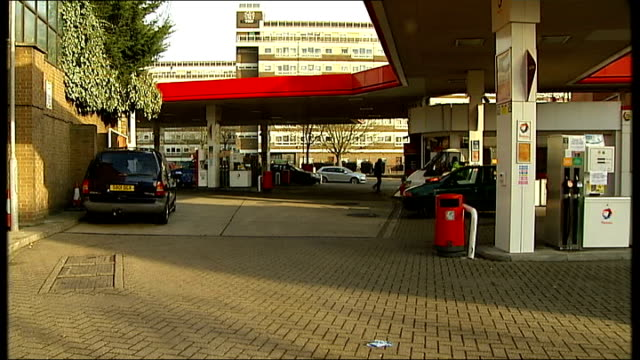 general views of petrol station / vehicles being filled with petrol ENGLAND London EXT General views of petrol pumps at petrol station forecourt /...