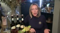 Rise in alcoholrelated hospital admissions London Woman mixing drink in Redemption alcoholfree bar PAN reporter to camera Close shot of nonalcoholic...