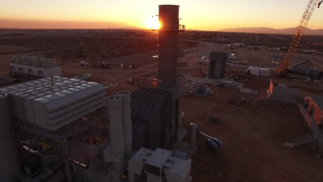 Rise up smoke stack sun reveal, Drone 4K Industry Aerial Video, Power plant coal, natural gas, wind farm, renewable energy, smokestack,