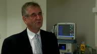 Bryan Mayou interview ENGLAND London Cadogan Clinic INT Bryan Mayou interview SOT / Mayou entering room and looking at medical equipment / Fabius...