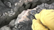 A risky POV shot of an person, jumping over a deep crevasse, Iceland