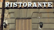 Ristorante sign on an building in Rome