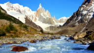 River below mountain peaks of Cerro Torre, Patagonia, Argentina