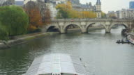 River boat for sightseeing on the Seine river, Pont Neuf, Paris, France