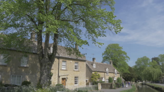 River Eye and riverside cottages in Lower Slaughter, Cotswolds, Gloucestershire, England, United Kingdom, Europe