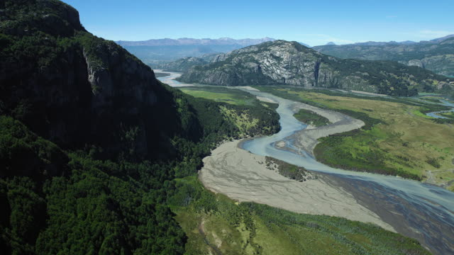 River Flows Through Mountains In Chile