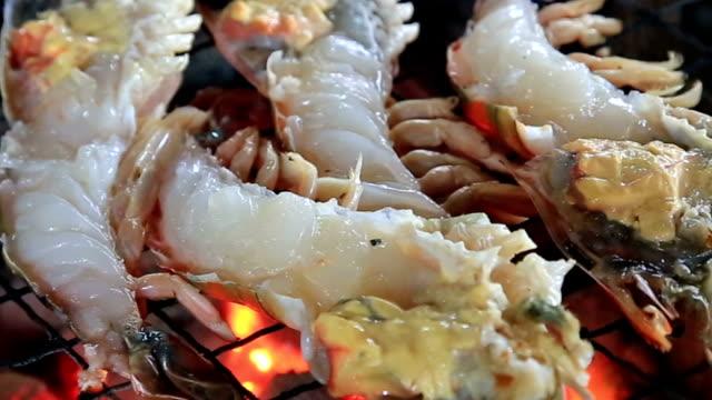 River lobster grilling