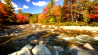 River through fall foliage, Swift River, New Hampshire, USA