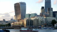 River view of the City of London at Dusk with Tourboat