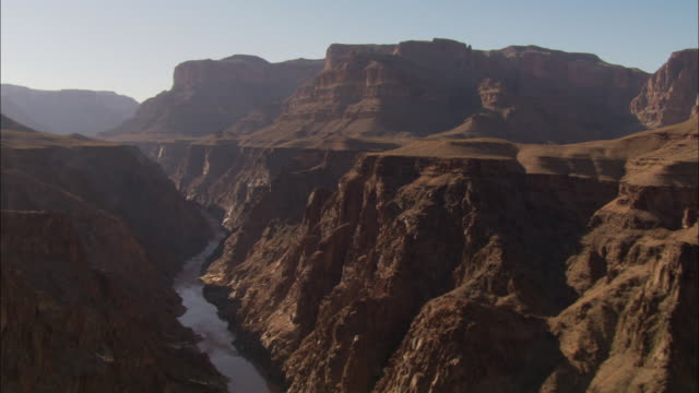 A river winds through a desert canyon.