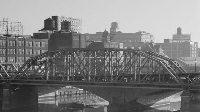 WS River with city Philadelphia and train running by on bridge
