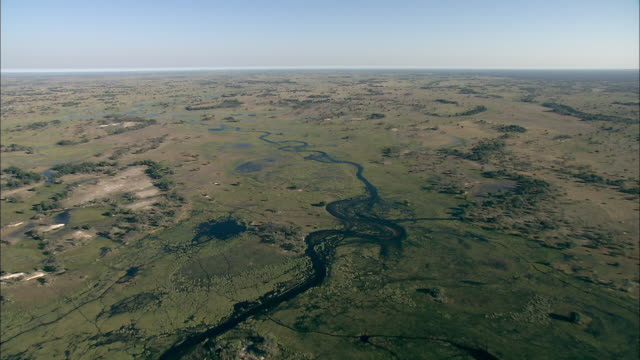 Rivers and waterways cut through the vast Okavango Delta in Botswana. Available in HD.