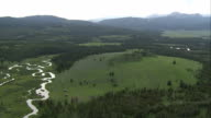 Rivers wind through lush woodlands in Yellowstone National Park. Available in HD.