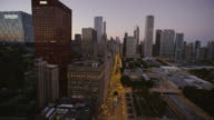 WS POV Road and skyscrapers in city
