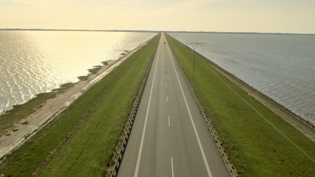 AERIAL Road crossing the sea on a dam